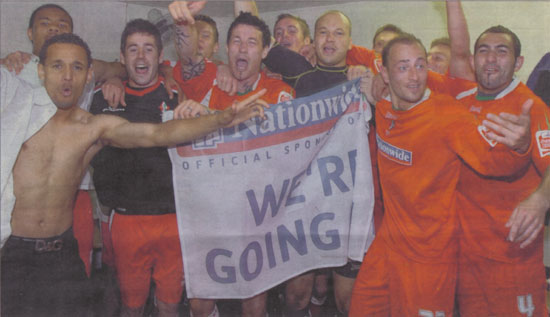 Celebrations after the Town clinch promotion against Walsall on the last match of the season